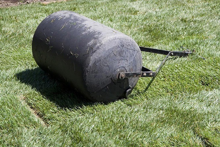 Lawn-roller-on-the-garden-how-to-lay-sod-over-existing-lawn