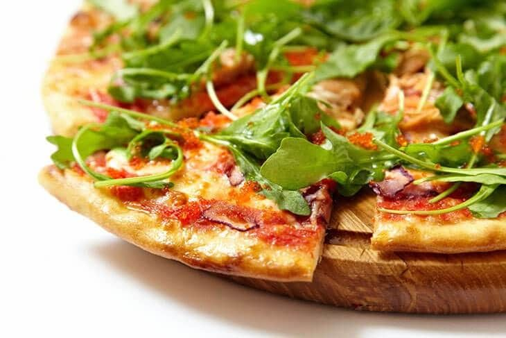 A-seafood-pizza-topped-with-Arugula-how-to-harvest-Arugula