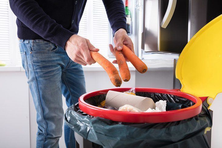 A-Person's-Hand-Throwing-Carrot-In-Dustbin-How-to-Tell-If-Carrots-Are-Bad-