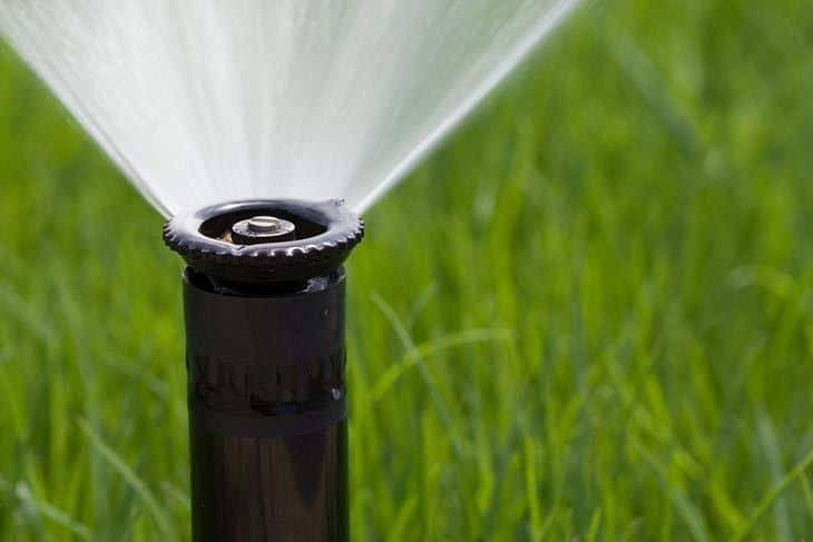 Detail-of-a-working-lawn-sprinkler-head-watering-the-grass